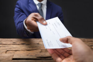 Homebuyer Giving Check To Title Company