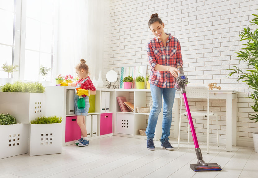 Mother and daughter cleaning house together